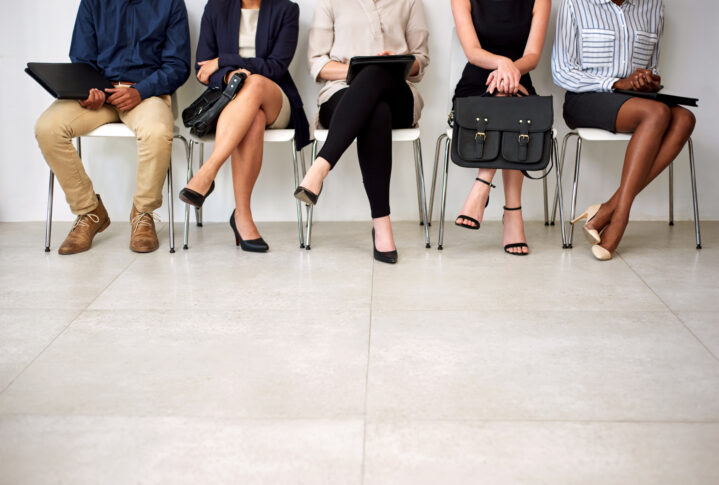 Shot of a group of businesspeople seated in line while waiting to be interviewed